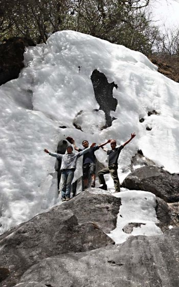 Frozen waterfall, our guide porters showing off