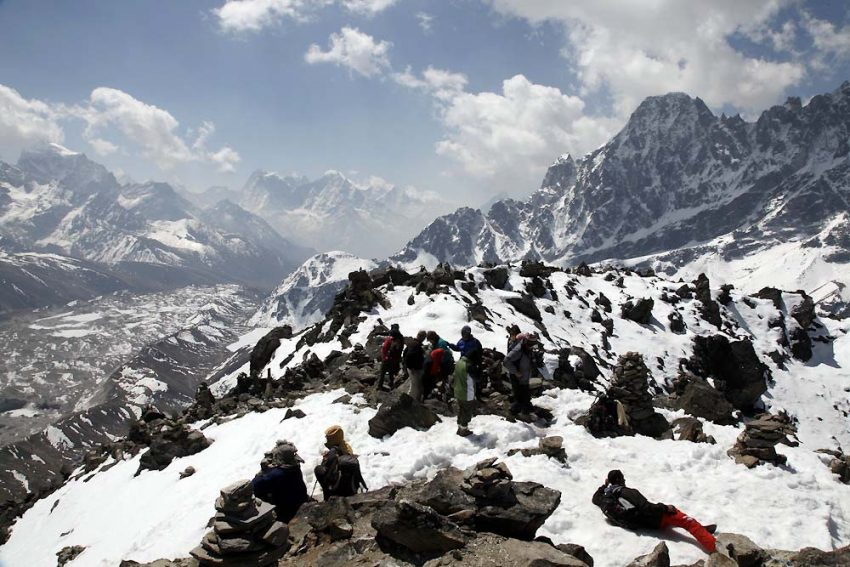 The rest of our party enjoying the spectacular weather on Gokyo Ri
