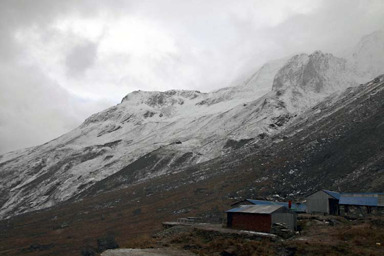 Annapurna Base Camp at dusk wreathed in cloud